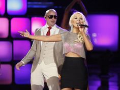 """[VIDEO] Christina Aguilera wows on """"The Voice"""" with vocals and croptop"""