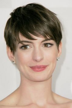 Best Popular Short Hairstyles with Bangs for Straight Thick Hair Women in Dark Brown Color with Long Faces