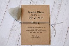Wedding Wish Bracelets, the perfect little gift for the new Bride and Groom. One for him and one for her. These bracelets are made from waxed cotton cord and hold a sterling antique silver heart charm. They are designed to be tied to your wrist with any excess cord cut off. All