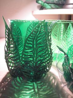recycled green plastic bottles cut or burned into leaf shapes