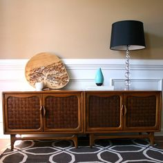 Mid-century console for living area next to fireplace or against entry wall.