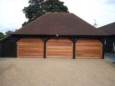 3 Timber bespoke Sectional Garage Doors fitted in Amersham, Buckinghamshire, The Doors were fitted with the Novomatic 553 Electric Door Opener for a whisper quiet open and close.