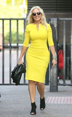 Carol Vorderman tries to take pole position in a racy outfit at the Grand Prix - 3am & Mirror Online