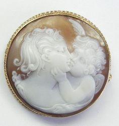 Angel or cherub kissing beautiful lady cameo brooch in gold