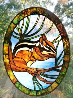 Stained glass chipmunk by Michelle Carlson, www.rockledgeglassdesign.com, featuring Uroboros and Youghiougheny glass
