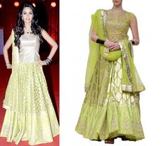 Mallika Sherawat was seen in this beautiful lime green lehenga by Anita Dongre available at strandofsilk.com! This exquisite lime chanderi brocade lehenga is paired with a lime embroidered net choli and is the perfect outfit for the young, trendy and confident modern women! #mallikasherawat #lime #green #lehenga #chanderi #brocade #embroidered #net #choli #anitadongre