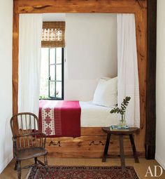 Cozy sleeping nook with steel mullioned window (that opens!). Napa home by architect, Bobby McAlpine. A child's guest room features a chalet-style box bed that has been nicknamed the Heidi Nook; the Windsor chair is 18th-century English.