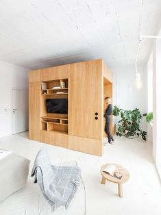 Projekt Praga transforms Polish brewery into minimal holiday apartments The self-catered rooms – each varying in arrangement – are minimally finished with an open plan arrangement and large wooden boxes that incorporate bathrooms and storage. Tiny Apartments, Tiny Spaces, Holiday Apartments, Small Space Living, Living Spaces, Casa Loft, Appartement Design, Interior Architecture, Interior Design