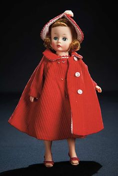 red corduroy coat and hat lined in red pin dots