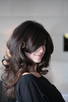 She has THE most amazing hair. It always looks fabulous