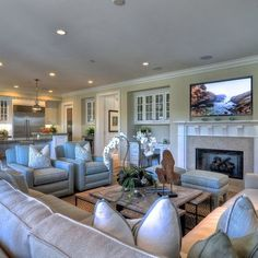 Coastal decor is found in the details in this spacious family room. upholstered light-sea blue chairs sit aside an off-white sectional sofa and additional Furniture Placement, Furniture Layout, Furniture Arrangement, Cheap Furniture, Furniture Stores, Sofa Layout, Furniture Websites, Furniture Ideas, Furniture Design