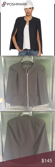 REDUCED! NWT Drew Cape Blazer New Black fully lined cape jacket. Very stylish with silver zipper.  Size extra small but fits more like a small. 78% poly 18% Rayon 4% Spandex Drew Jackets & Coats Capes