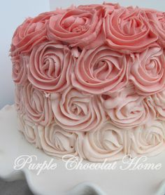 Great tutorial on making an ombre cake..and frosting recipe included! Tip for getting cake out of pan perfectly..cut parchment to fit bottom of pan, use knife to loosen edges and dump cake onto cooling rack. Remove parchment paper when cake is cool.