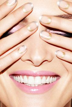 """The """"negative space"""" manicure is a current trend in nail art, where part of the nail is left bare.  (Photo:  Samantha Rapp for The New York Times)"""