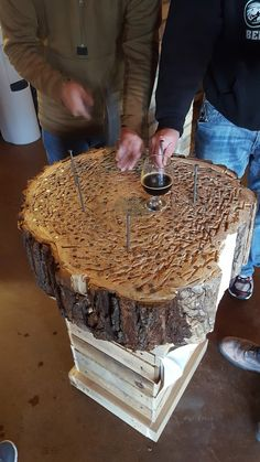 Hammerschlagen - Basically you see who can dive their nail in first. You get one swing at it per round. You use the chisel end of a riveting hammer. First one to get the nail head to touch the log wins. Beer is involved.  #Hammerschlagen Like