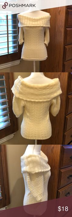 MODA International cream short sleeved sweater S MODA International cream short sleeved sweater In size small.  You can wear it off shoulder or as a cowl neck sweater.  Excellent condition.  Armpit to armpit is 14.5 inches Shoulder to bottom is 23 inches Moda International Sweaters Cowl & Turtlenecks
