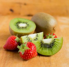 Check out Kiwi fruit and strawberries by Grounder on Creative Market