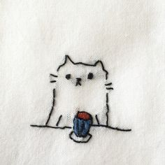from Tumblr: rioysd: 昨日の中野手作り市で買ったおばあちゃん手作りふきんの刺繍ネコが可愛すぎる。