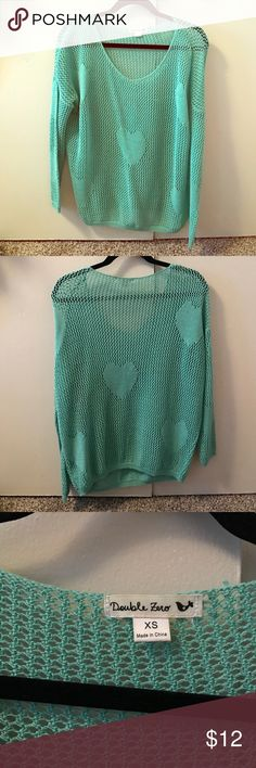 NEVER WORN teal sweater NEVER worn teal sweater with hearts throughout the sweater. Super cute and stylish, it's see-through with mesh like little holes throughout the sweater. Scoop neck style. Double Zero Sweaters Crew & Scoop Necks