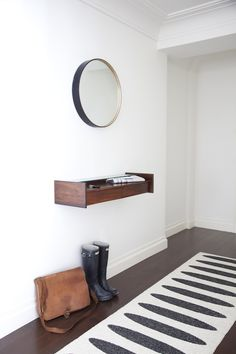 A custom mirror from BDDW in the entryway with a Pappalino Floor Mat from Just Scandinavian.