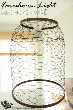 """DIY:  Farmhouse Light With Chicken Wire """"Shade"""" - this is brilliant! Chicken wire, 2 embroidery hoops & spray paint transform a plain light fixture."""