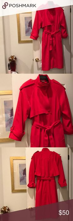 Fabulous Looking, The Water's Edge Red Trench Coat You'll be Singing in the Rain when you wear this fabulous looking, red trenchcoat by Michelle Stuart, The Water's Edge. It's I s in great condition! The coat was made in Korea. So, you know, it was well-made. The details on the coat, are just lovely. It has all the buttons, has a removable lining and the back has this lovely design. Please look at the pictures. Michelle Stuart Jackets & Coats Trench Coats
