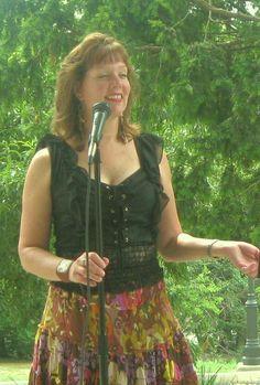 Poet Diane Sahmis-Guarnieri performing her works