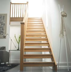 Diy Stairs With Landing square oak open riser staircase home open Source: website diy staircase renovation completed weekend home Sour. Staircase Bookshelf, Staircase Landing, Winding Staircase, House Staircase, Staircase Design, Staircase Ideas, Timber Stair, Open Stairs, Traditional Staircase