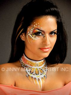 Colorful and creative face and body art accented with gems by Jinny Makeup Artist Inc.