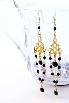 A personal favorite from my Etsy shop https://www.etsy.com/listing/476889565/black-and-gold-chandelier-earrings