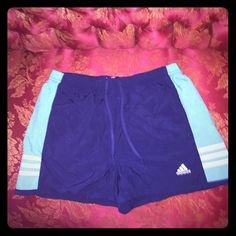 ADIDAS Sports Shorts (reflective material) ADIDAS Sport Shorts in a navy/teal color w the sides in a deadpan green. Reflective jogging stripes on either sides & front pockets, as well as drawstring if needed. Perfect for around the house, working out, swimming, or just a really hot sticky day?!! Never worn. NWOT. As always prices negotiable. Respectively. Thanx! ✌️ Adidas Shorts