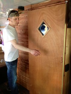 stained glass tiny house free range quest cabin bus conversion sliding barn door wood rv cheap DIY