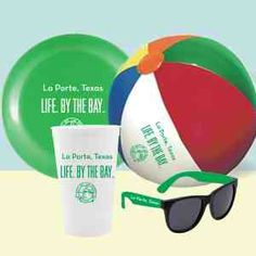 """CUP Fun Beach Kit #2 -- 22 oz. US made stadium cup (red, blue, black, white, green, orange, yellow & clear), 9.25"""" US made flying disc (red, blue, yellow, white, green, pink, orange), 9"""" multicolor beach ball & a pair of sunglasses (red, blue, yellow, black, white, green, pink, purple, orange) packaged together in a mesh sleeve. 1 color imprint per piece included."""