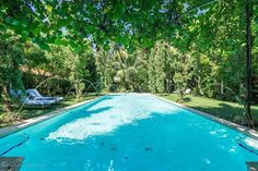 Pool Perfection: The four-bedroom main villa is complemented by three additional guest villas that house four more bedrooms. The centrally located Gatsby-style pool can be enjoyed by family and guests as all villas open on to it. Check out more luxurious pools on http://ift.tt/1XApJeg and view this home on LuxuryPortfolio.com Web ID: DKEW #LuxuryPortfolio #LuxuryRealEstate #PalmBeach #Florida #Pools #KeyesCompany