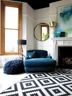 Black and white living room with dark blue elements for elegant feeling.
