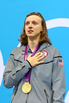 Olympics Day 7 - Swimming. Katie Ledecky, the USA team's youngest member, wins gold.