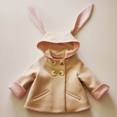 Bundle up your honey bunny in this cuddly coat. Fashioned from velvety wool felt and lined with plush organic cotton fleece, this fluffy topper will keep your little hopper extra cozy. Its sweet hood is topped by long, deliciously soft ears; cuffed sleeves roll down on extra-blustery days; and welt pockets are perfectly sized for warming chilly paws. Using grown-up dressmaking techniques, every inch of this charming child's topcoat has been exquisitely crafted inside and out to be the cutest…