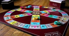 Michael Wurstlin, eighteen, designs the board for Trivial Pursuit. Game creators Chris Haney and Scott Abbott had hired Wurstlin to fashion the look for Trivial Pursuit. Trivial Pursuit, Family Board Games, Fun Board Games, Taboo Game, Game Creator, Useless Knowledge, Lets Play A Game, Odd Couples, Dating Apps