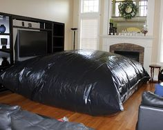 An inside tarp bubble tent for rainy days! This blog has multiple other things to do for kids on rainy/snowy days.