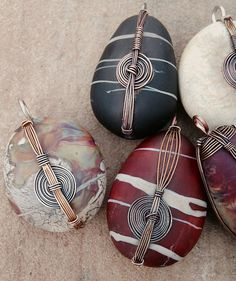 Glass rocks with wire wrapping by Libby Leuchtman