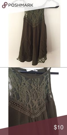 New top M Strappy halter style green top. Has lace detailing. Worn once or twice only. Tops Blouses