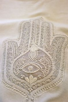 The Hamsa, also known as the Khamsa, the Humes hand, the Hand of Fatima and the Hand of Miriam, is a popular symbol found throughout the Middle East and northern Africa, particularly within the Islamic and Jewish faiths. It is one of the national symbols of Algeria and appears in its emblem.