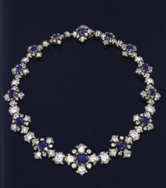 Blue sapphire and diamond necklace (without its pendant) which once was the property of Queen Victoria. It also had a matching pendant which could be worn with it. There was, of course, the matching tiara and other pieces. All seem to have been sold by the late Earl of Harewood, who was the son of Princess Mary (George V's only daughter and great-granddaughter of Queen Victoria), who must have inherited the necklace, the matching tiara, pendant and bracelet.