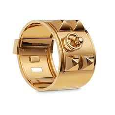 The iconic Hermes Collier de Chien bracelet in solid 18K yellow gold.