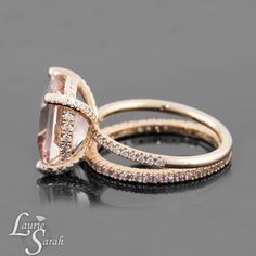 This is my dream. 5 carat Peach Pink Morganite center cushion cut stone surrounded by pave diamonds and pave prongs! Comes with eternity band. B-E-A-UUUUUTIFUL