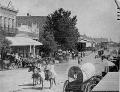 "Traces of Texas reader Tom Chambers kindly sent in this nifty photo of downtown Nocona, Texas, at some point in the distant past. Looks to be about circa 1900. What a true ""western looking"" image. You have to love that wagon!"