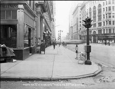 Marbridge Building at left with elaborate entrance columns; Saks 34th Street, Gimbels at right, June 27, 1940 (NYC Dept of records archives)