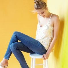 Brighten up your favorite medium or dark wash jeans with an airy pastel tank.