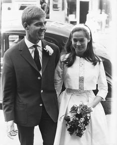 Actress Nancy Kwan married Austrian ski instructor Peter Pock at the Paddington Registry Office in London. For the simple ceremony, Kwan chose a lace and shantung silk dress with a matching bolero jacket and statement headband. #southernfashion #vintageweddingdresses #iconicweddingdresses #vintagesouthernstyle #southernliving