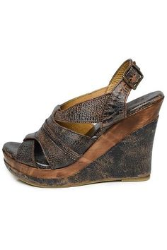 """New for the season GAYLE boasts our leather wrapped wooden wedge. The sleek upper design is beautiful on the foot and the buckle adjusts for a comfortable fit. • Distressed leather slingback • Low cut front for a sleek fashion look • 4 """" wooden wedge with a 1.25"""" platform • Rubber sole for traction • Made in Mexico Suggest ordering a half size up."""